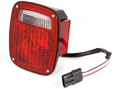 Omix-ADA Right Side Tail Light W/ Black Housing (87-90 Wrangler YJ)