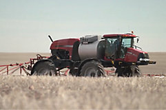 Red sprayer in field