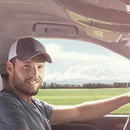 Farmer in Truck Cab