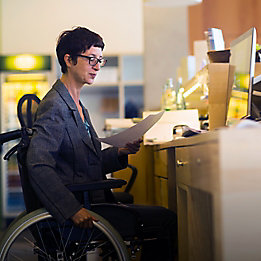 Woman in wheelchair at computer