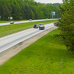 Image of four lane highway with grass median