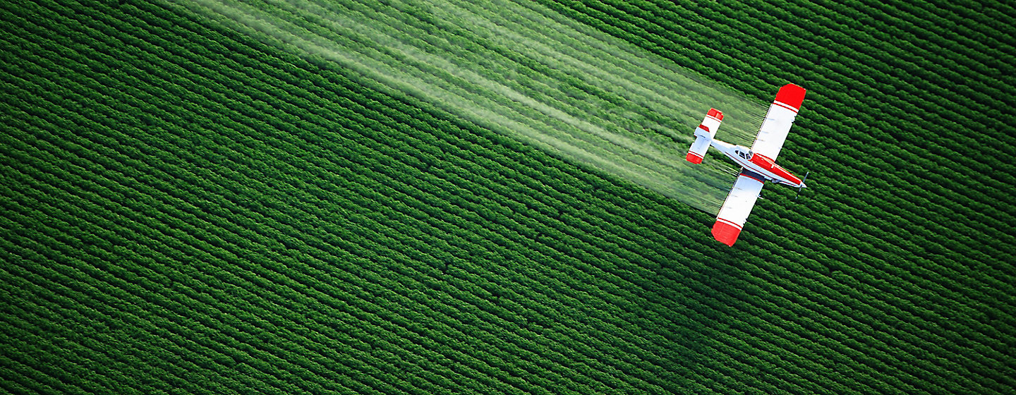 Image of arial spraying of crop field