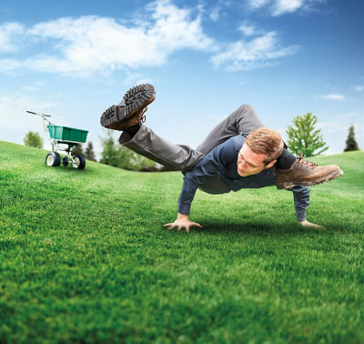 Image of man over crabgrass