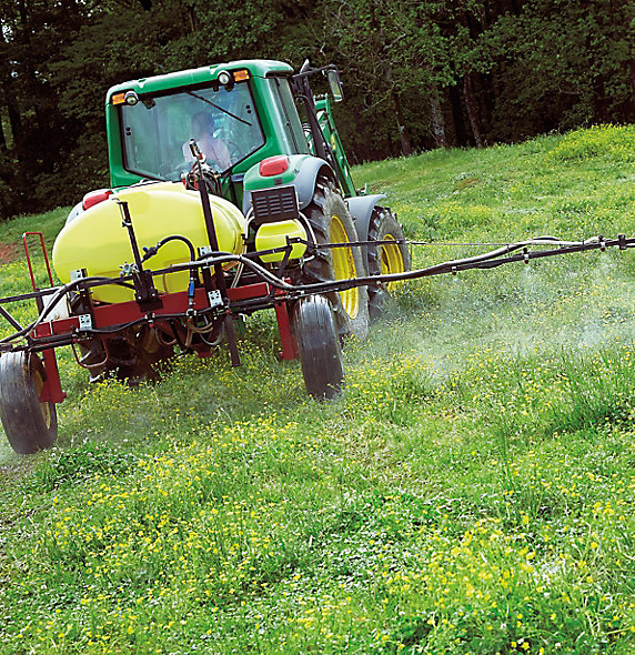 Image of tractor spraying pasture