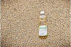 Bottle of Plenish in soybean seeds