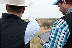 Ranchers surveying land
