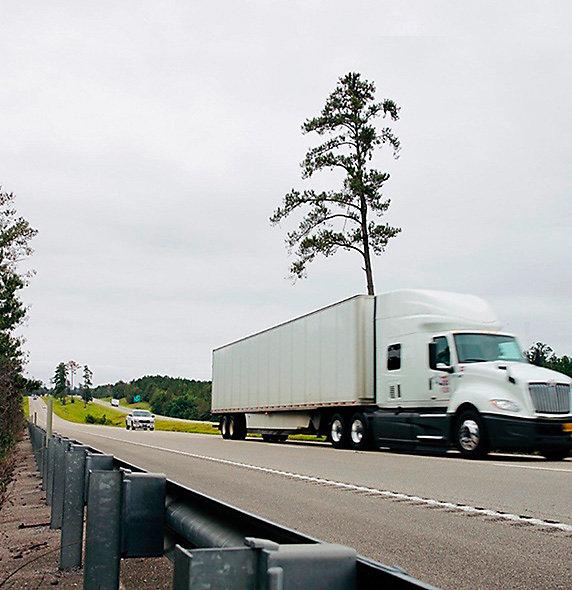 semi driving on highway