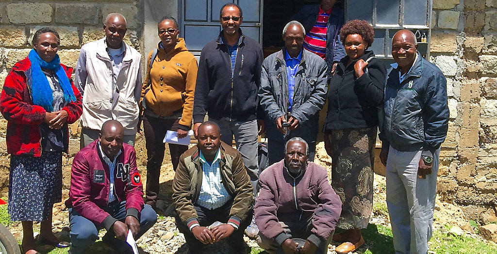 Quannambile Cooperative Leaders in front of their new storage and milling complex