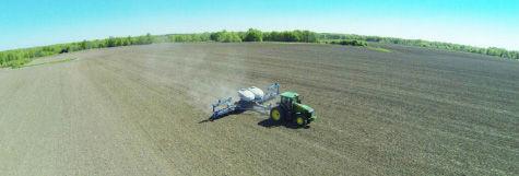 Planting a Pioneer multi-hybrid trial in 2015.