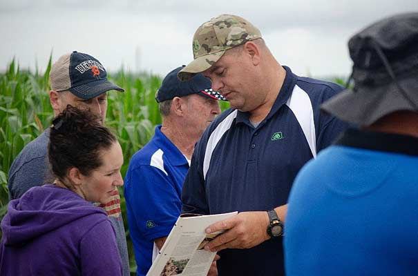 Photo - Pioneer Field Agronomist Scott Dickey sharing crop management information with a S.A.V.E. participant.