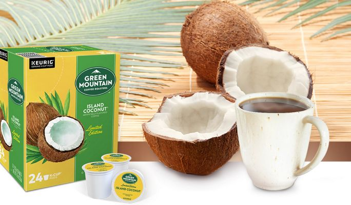 Island Coconut K-Cups next to a mug of coffee and coconuts