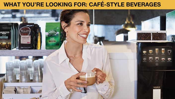 What you're looking for: Cafe-Style Beverages. Image of woman holding coffee and smiling.