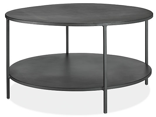 slim round cocktail table in natural steel - modern cocktail