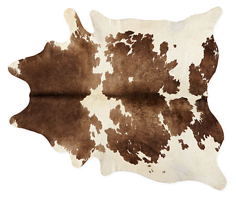 Cowhide Rugs on outdoor tables and chairs
