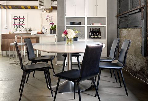 The oval pedestal Julian table with durable bonded leather Hirsch dining chairs make the perfect spot for team meetings and lunch.