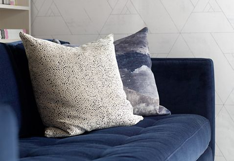 Accessories like these luxury velvet pillows give this modern office a touch of glamour.