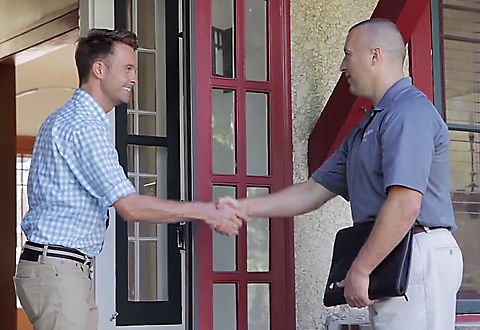 Our Delivery Associate greets a customer for a full-service, white-glove delivery to his home
