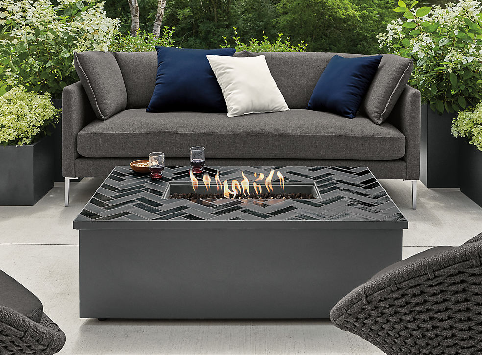 Detail of Adara square fire table in black with tile top on patio