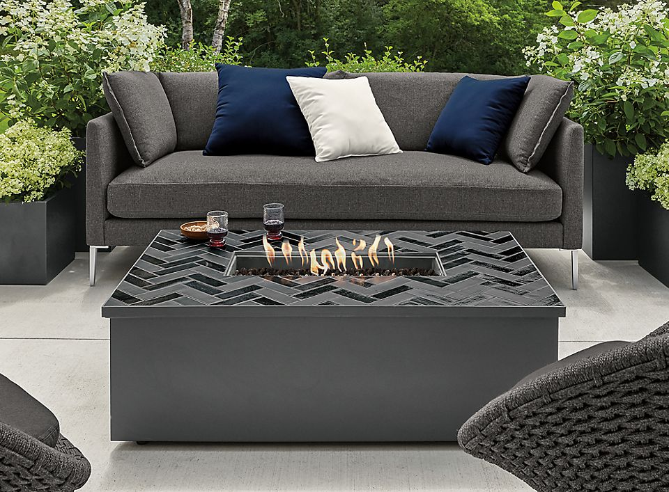 Patio with Adara outdoor fire table in graphite with tile top