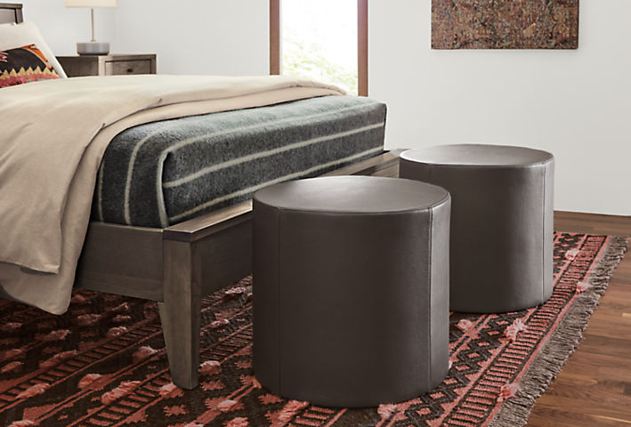 Detail of Aero leather ottomans at end of bed