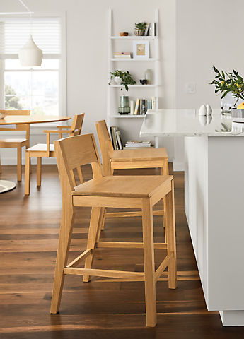 Side view of Afton counter stool in white oak