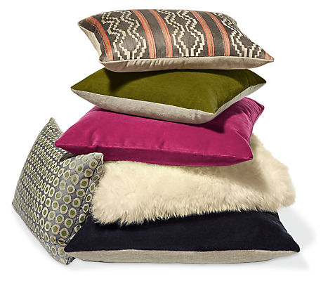 Stack of white, green and pink throw pillows