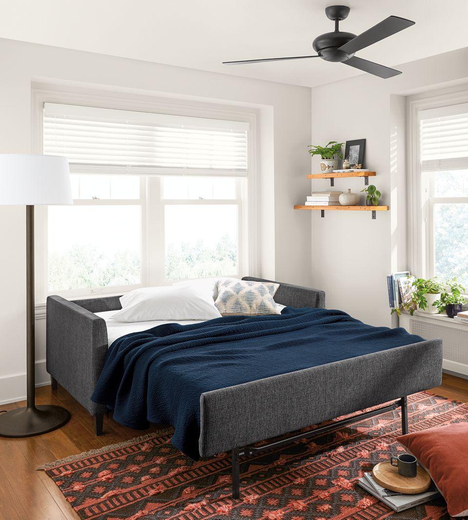 Allston sleeper sofa open with bedding