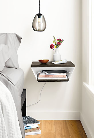 Detail view of Alta wall shelf near bed