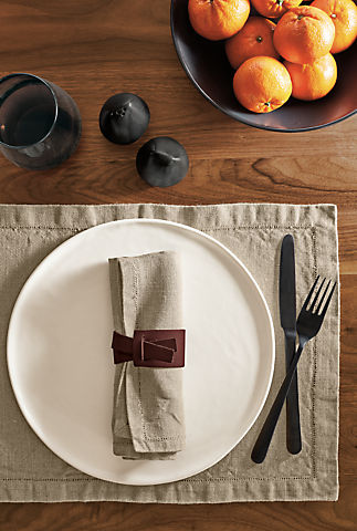 Detail of Verza leather napkin ring in place setting