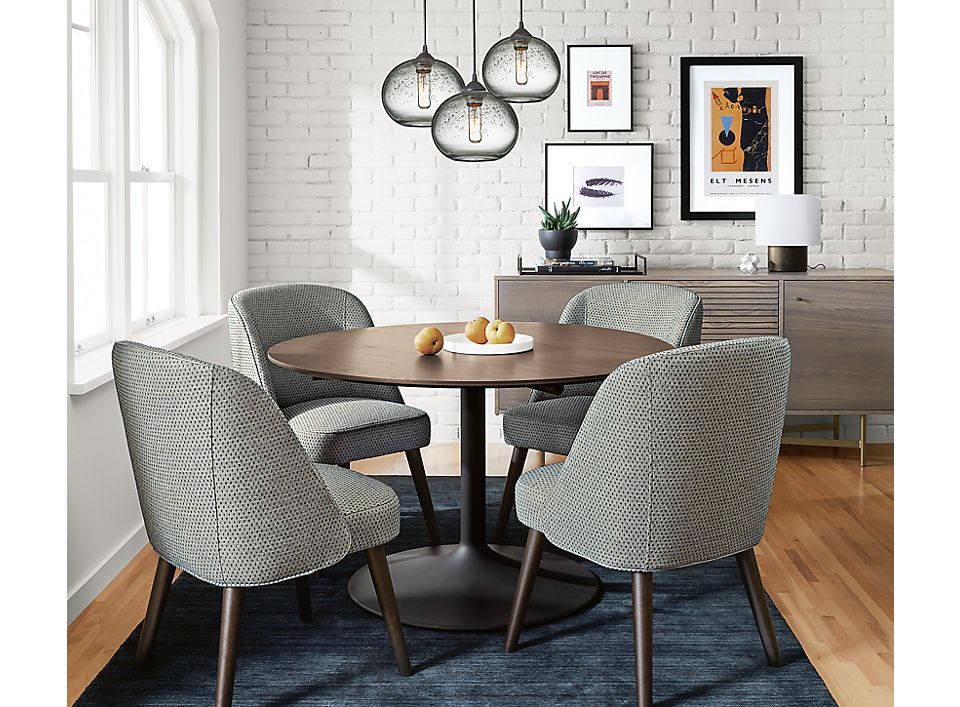 Detail of Aria table and Cora chairs in dining room