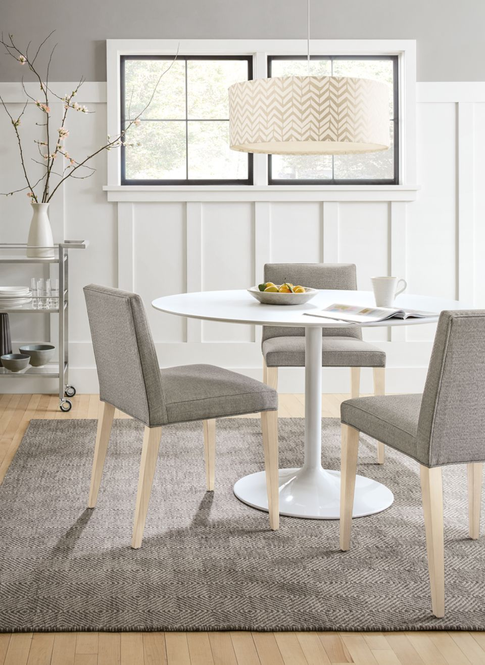 Side view of Aria round dining table in white