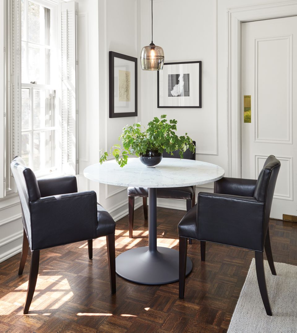 Detail of Aria round dining table in apartment