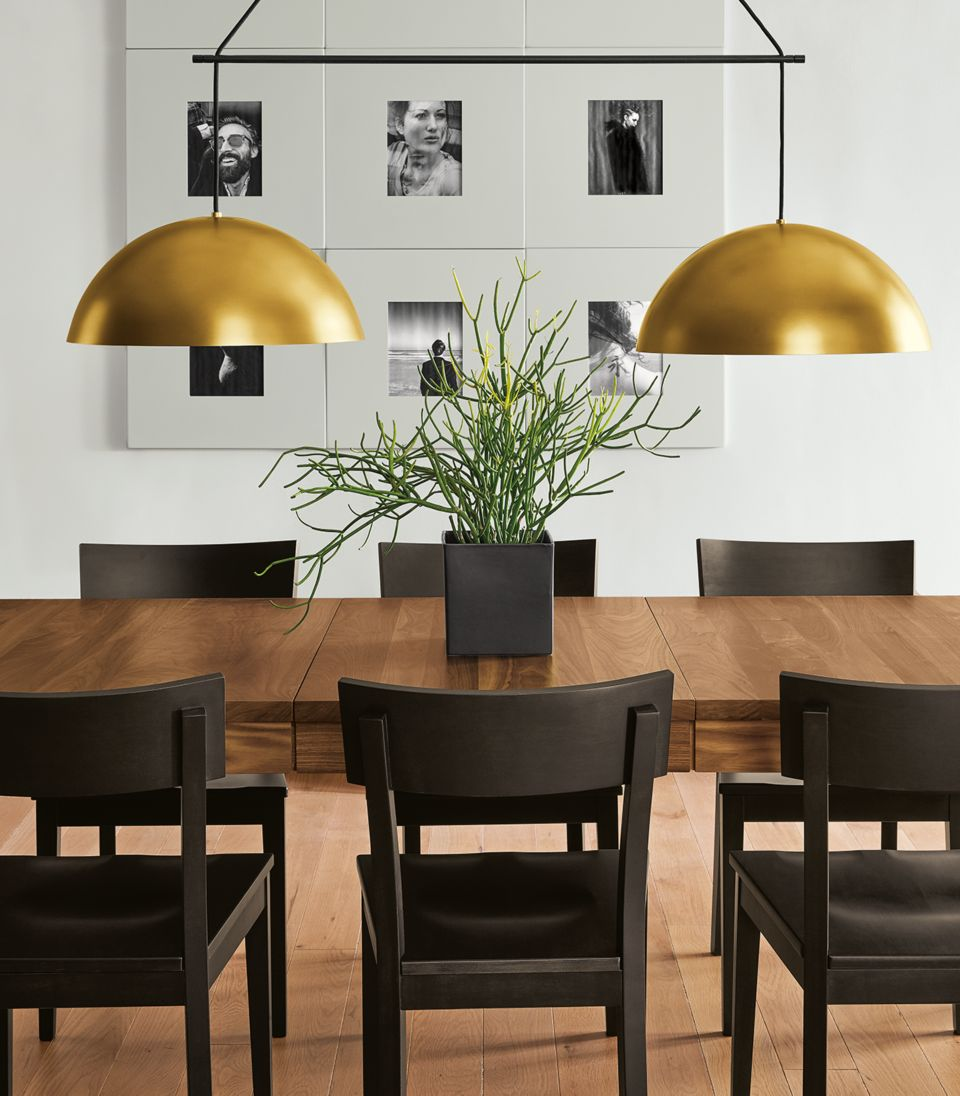 Detail of Aurora doubel pendant fixture in brass above dinner table