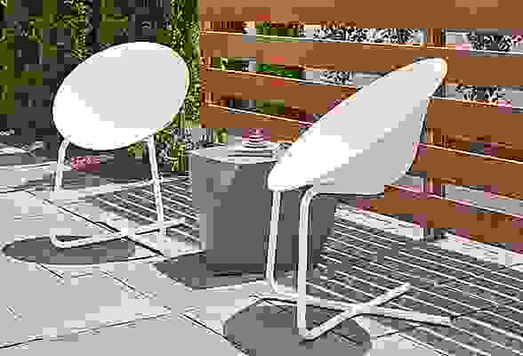 Side detail of Azhar outdoor white chairs