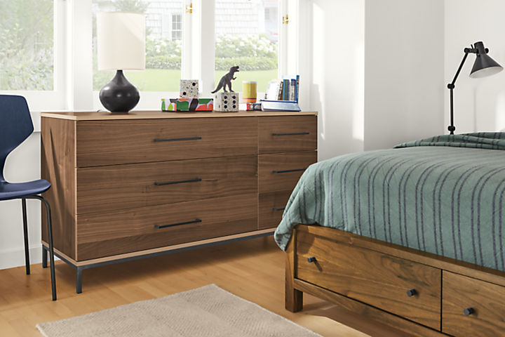 Detail of Baker 6-drawer dresser in walnut in bedroom