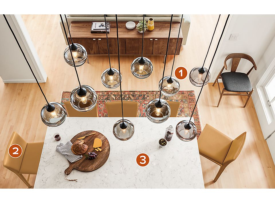 Grouping Of Banded Gl Pendants Over Kitchen Island