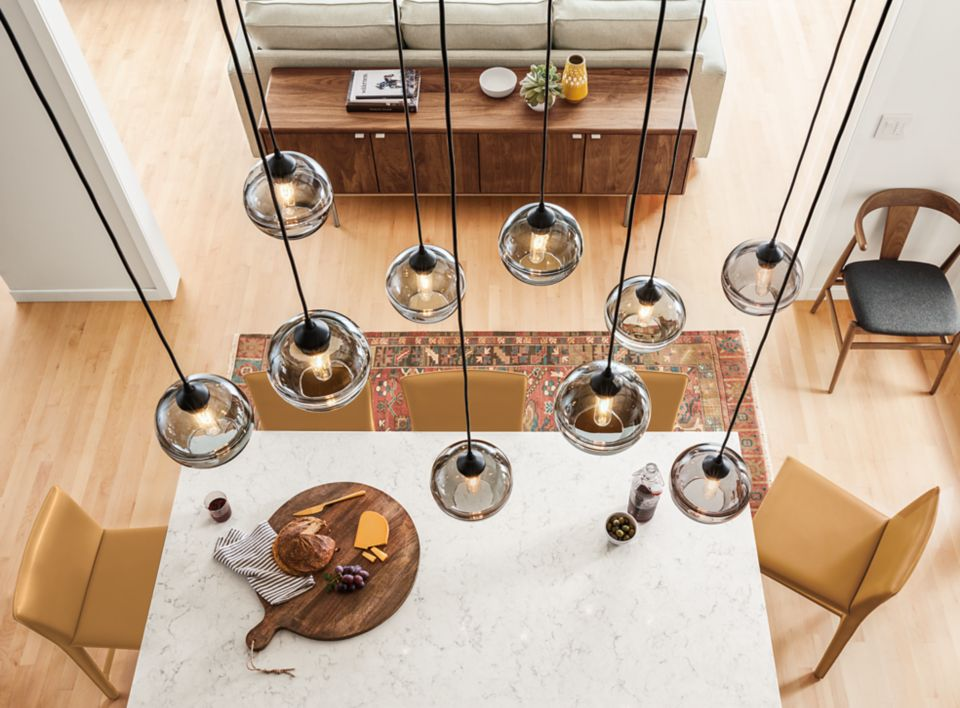Grouping of Banded glass pendants over kitchen island