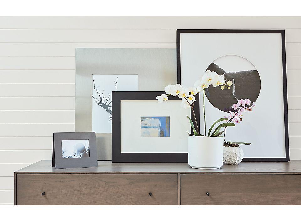 Close detail of four frames on dresser