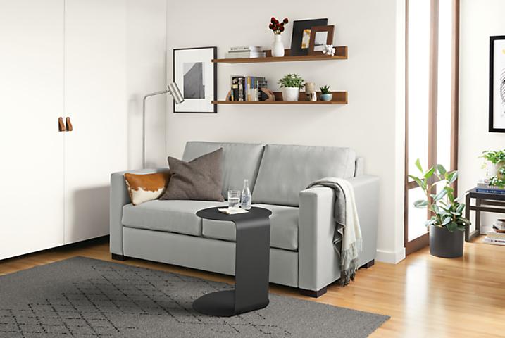 Detail of Berin wide arm low sleeper sofa