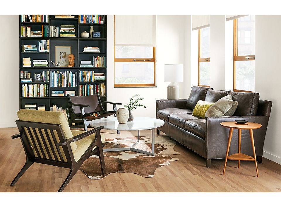 Modern Living Room With Leather And Fabric Sofa Chairs