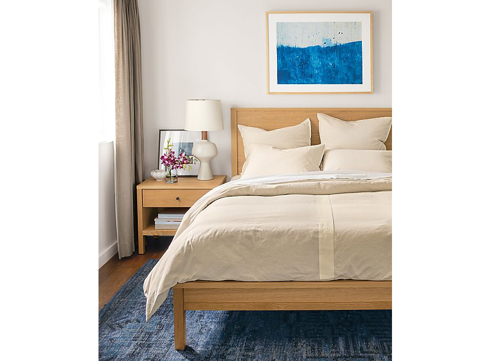 Detail of Brandt duvet cover on queen white oak bed