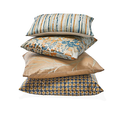 Detail stack of throw pillows in camel