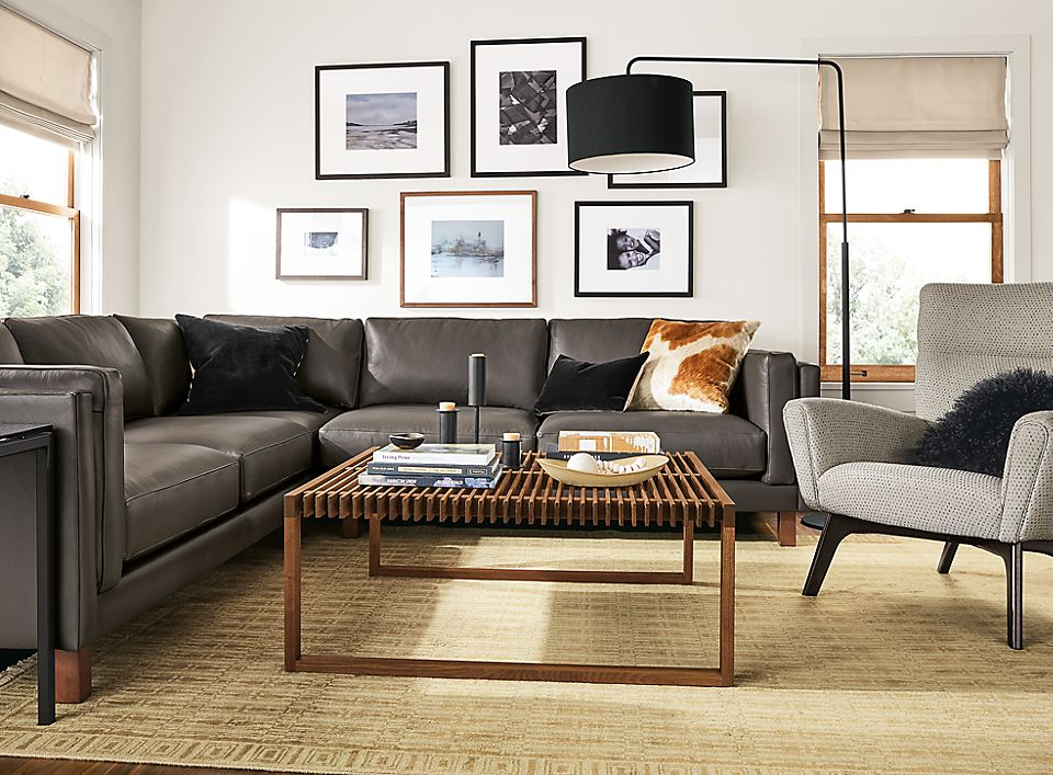 Detail of Cade sectional in Urbino smoke leather in living room setting