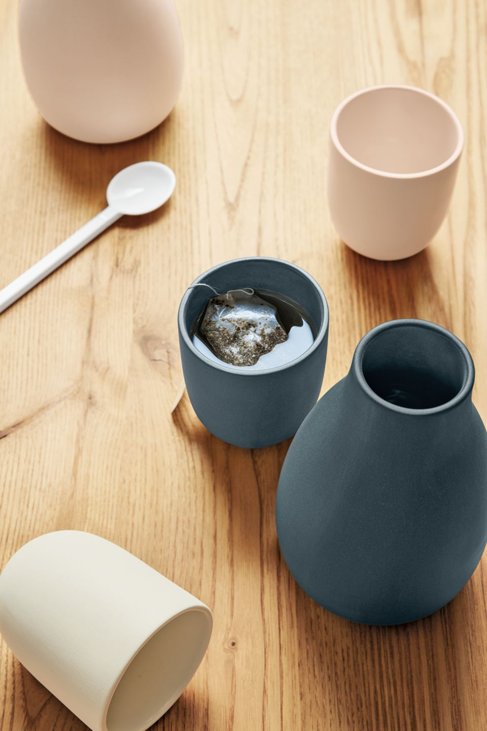 Detail view of ceramic Cadence carafe and tumblers