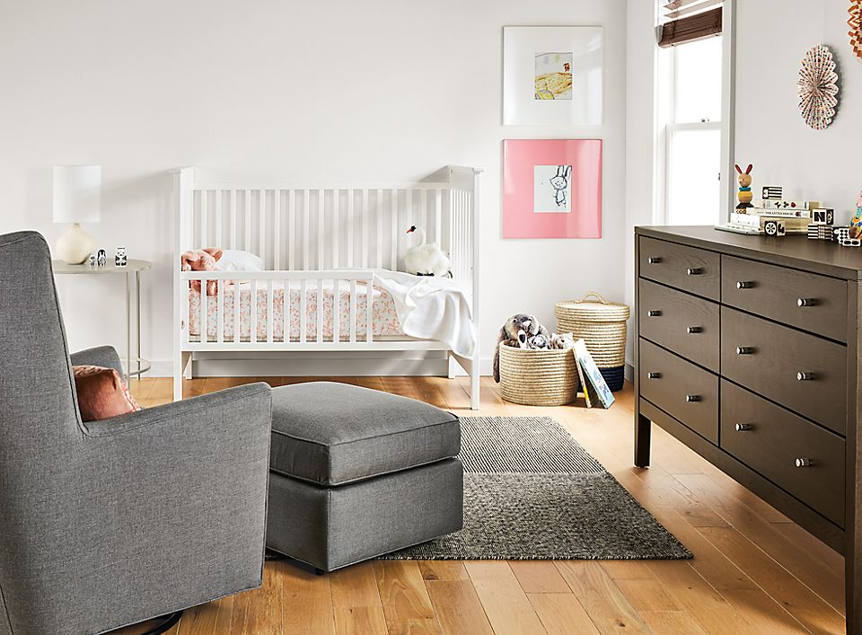 Minimal baby room with white Nest crib and Calvin dresser