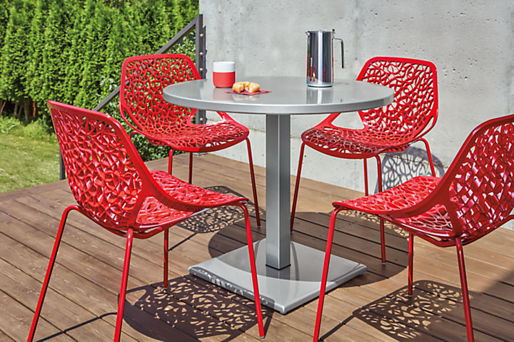 Detail of red Caprice outdoor dining chairs on patio