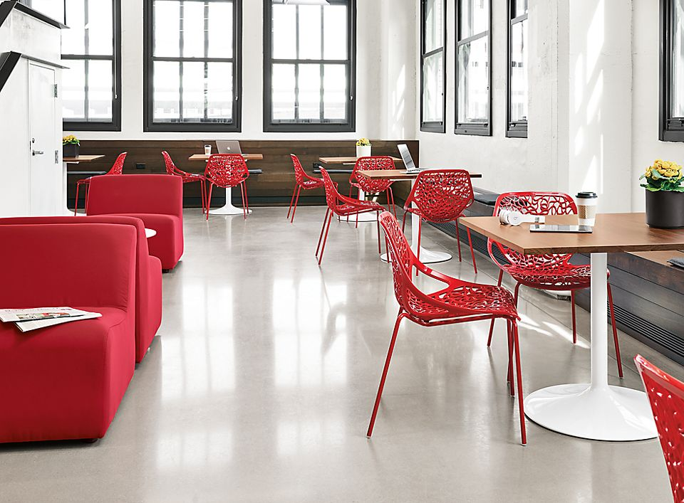 Detail view of red Caprice side chairs in modern office