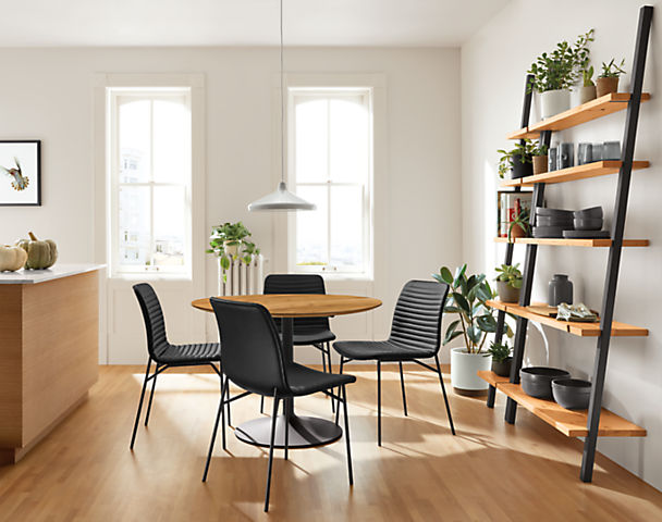 Four Cato side chairs in synthetic leather