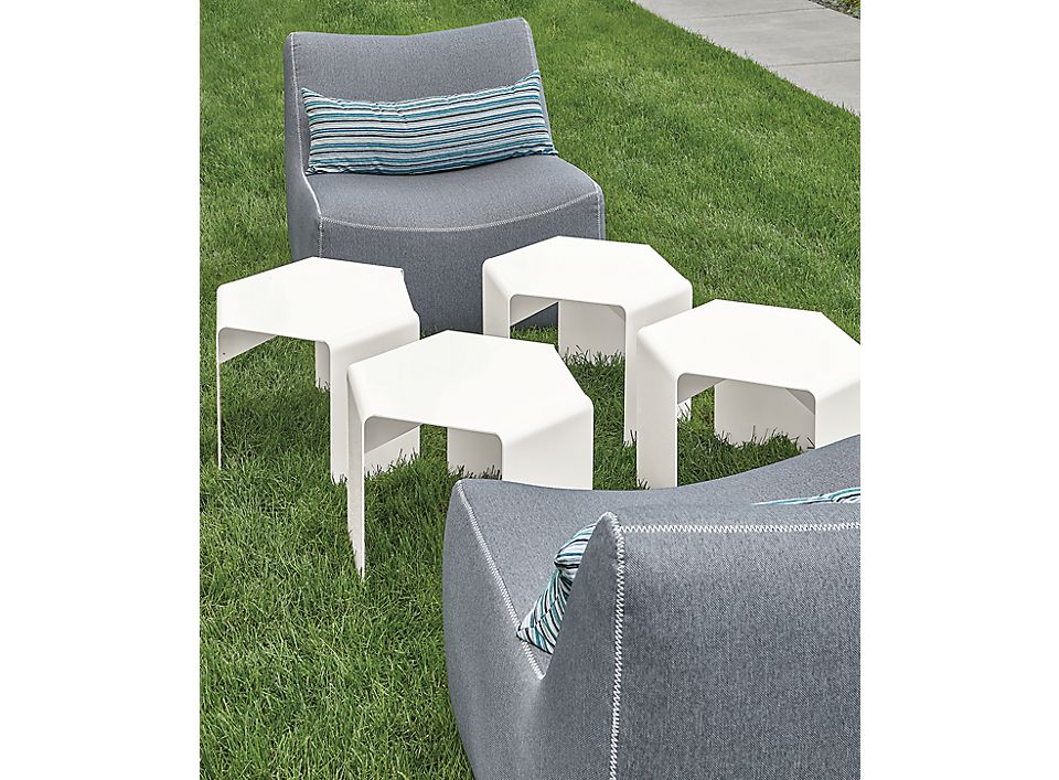 Detail of Cell outdoor side tables in white and Maya chairs