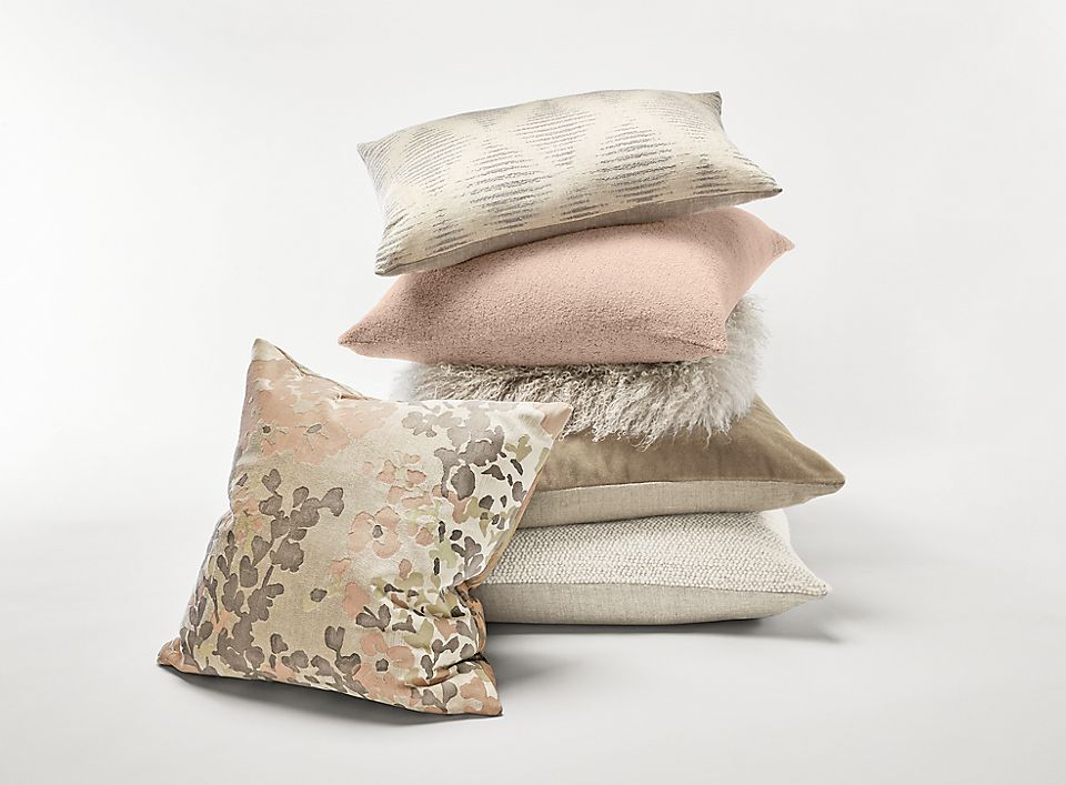 Detail stack of throw pillows in blush